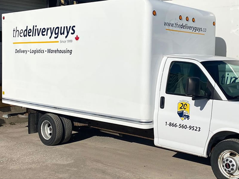 The delivery guys graphic lettering on delivery truck